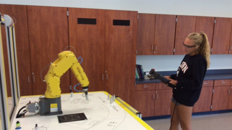 SME-PRIME---Central-Columbia---Student-operating-Fanuc-training-robot.jpg