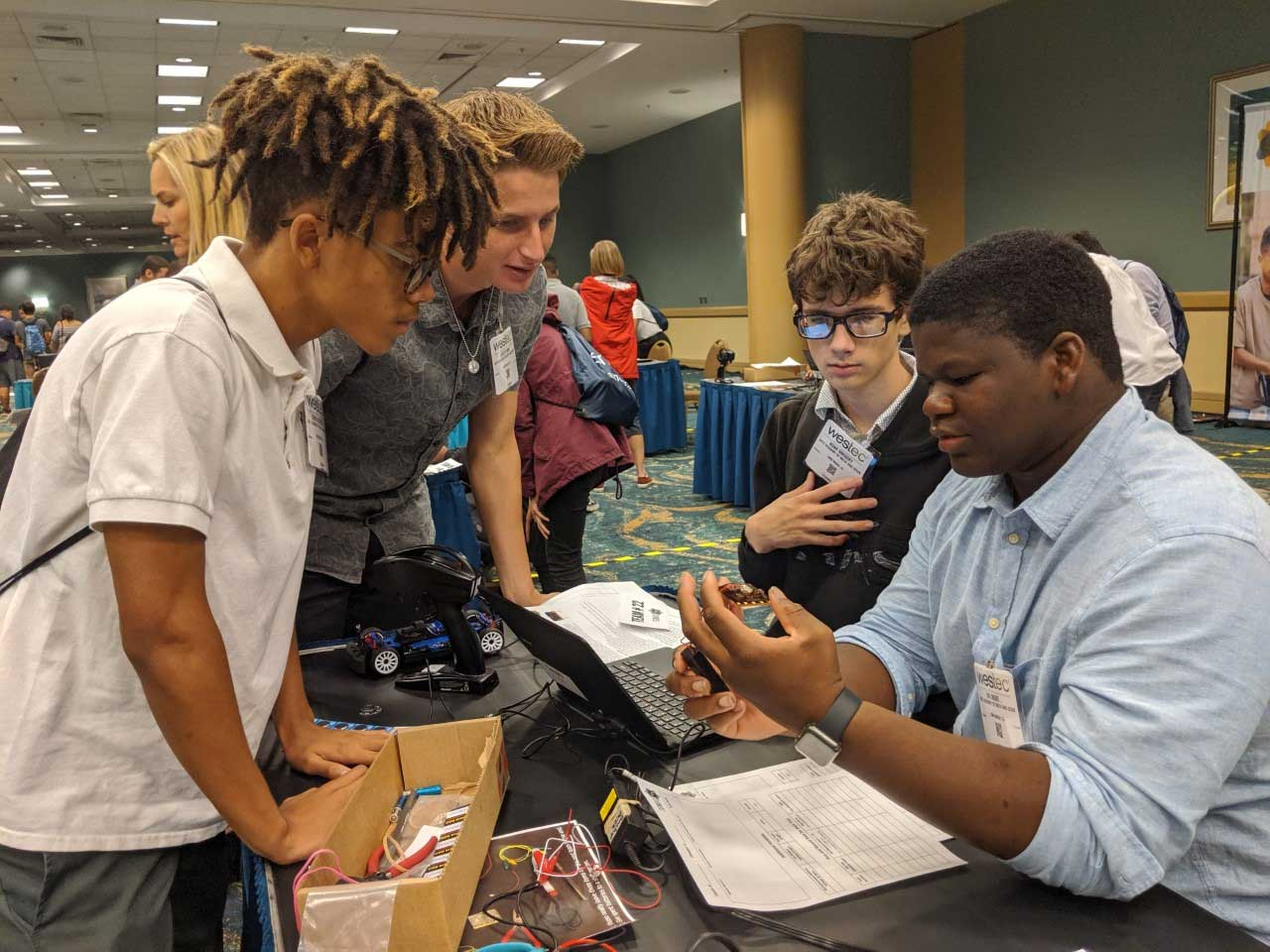 WESTEC-2019---Tobias-McIntosh,-Obiora-Okeke,-Jayce-Ferris-and-Noah-Gregory-working-on-their-race-car-with-data-collection-and-analysis.jpg