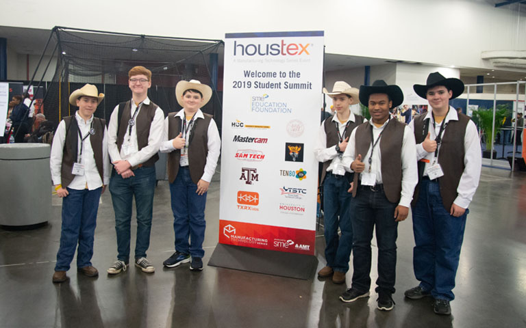 HOUSTEX - High School Students in front Student Summit banner
